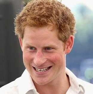 British newspapers have decided not to publish internet photographs showing Prince Harry naked in a Las Vegas hotel room