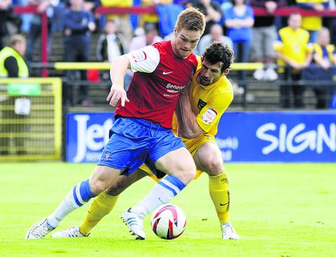 Jake Wright keeps tabs on York's Jason Walker