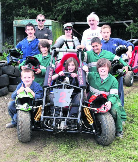 Rear, from left, Trax staff members Matthew Wilde, Helen Bates and Ken Chrisp; middle from left, Matthew Leach, Jake Banbrough, Kyron Stevens, Adrian Scott; front from left, Alex Haselgrove, Max Johnston in the driving seat, and Harry Lyons