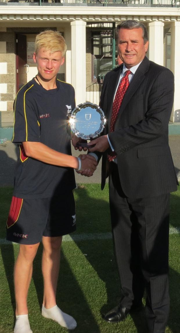 Miles Hammond receives the player of the tournament trophy from Standard Bank representative David Stead at last week's Jersey Festival