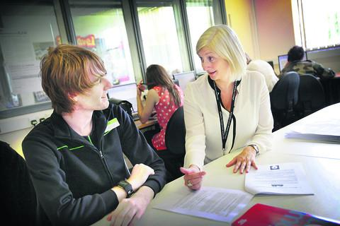 Assistant principal Fiona Morey talks to Abingdon and Witney College Jamie Bell about the new system