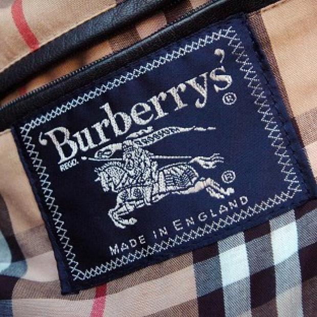 Burberry warned pre-tax profits for the year to March 31 will be around the lower end of market expectations
