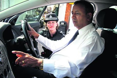 Sgt Katrina Hibbert with Steve Lal, a Bicester taxi driver