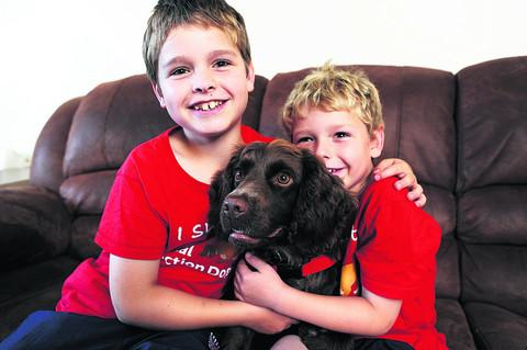 Nine-year-old Steven Courtney with Molly and his younger brother C