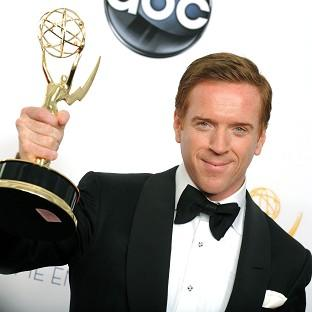 British actor Damien Lewis holds him Emmy, awarded to him for his role in Homeland (AP)