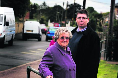 Ambrosden Parish Council deputy chairman Maureen Cossens and chairman Mark Longworth and are unhappy because half of their village has been wiped off the map in a development blueprint
