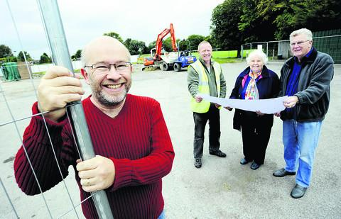Bicester Advertiser: Parish council chairman Mark Gray, left, with site manager Gary Small, parish councillor Marilyn Dyer-Lynch and working party member George Crockett