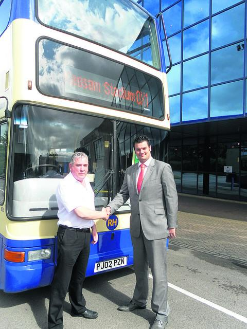 Dilwyn Roberts from RH Buses and Oxford United business development manager Owen Clark at the launch of the supporters' bus service in August