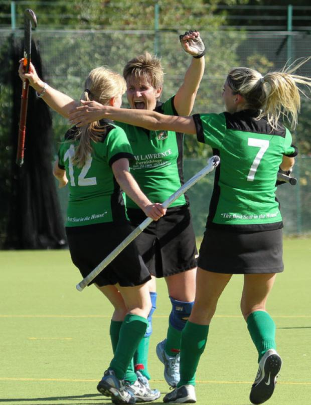Bicester's (from left) Lilla Venning, Kath Ryan and Susie Miller celebrate Venning's goal against Wokingham