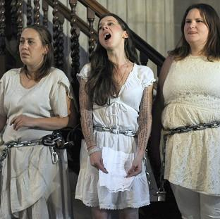 Activists from the Occupy movement staged a protest by chaining themselves to the pulpit in St Paul's Cathedral, London