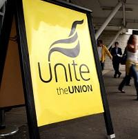 Unite union members are staging strike action over fears of compulsory job cuts at Amnesty International