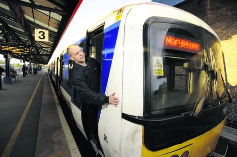 Bicester Advertiser: Banbury train driver Richard Smith checks the destination on the front of a train at Oxford station