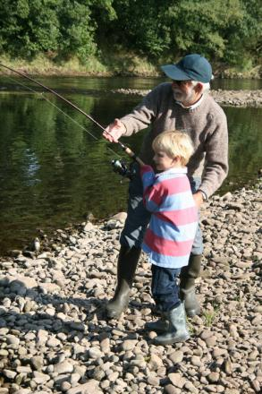 Stadhampton's Julian Humm, chairman of North Oxford Angling Society, is assisted by his four-year-old grandson, Charlie Wheatley, when fishing for salmon on the River Usk in South Wales