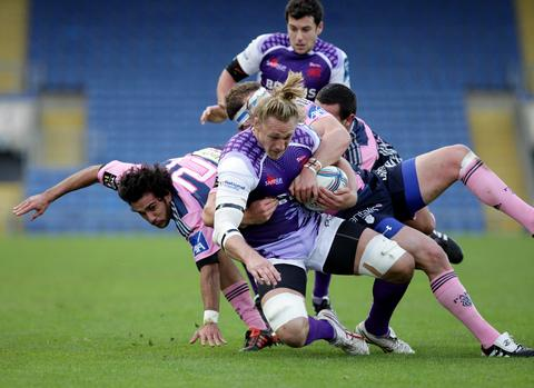 Martin Purdy is put under pressure in London Welsh's 68-19 to Stade Francais at the Kassam Stadium