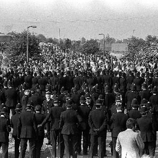 Police waiting for pickets in May 1984 as they head towards to the Orgreave Coking Plant, near Rotherham, during the miners' strike