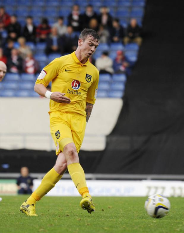 Michael Raynes could keep his place in Oxford United's starting   line-up, despite skipper Jake Wright being available again