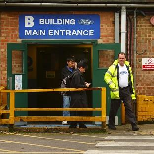 Workers leave the Ford Transit Assembly Plant in Southampton, after being told that the site will close with the loss of up to 1,500 jobs