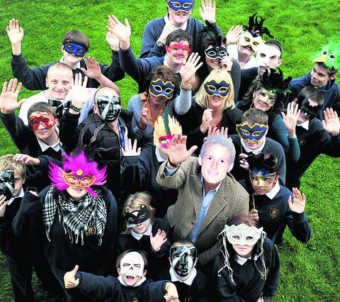 Woodeaton Manor School pupils and masked ball organisers, including Lesley Gascoigne