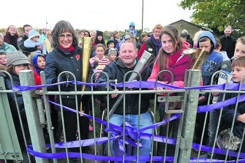 Olympic torchbearers cut the ribbon at the Harwell playground – from left, Fiona Danks, Dave Bracher and Emma Cuthbertson