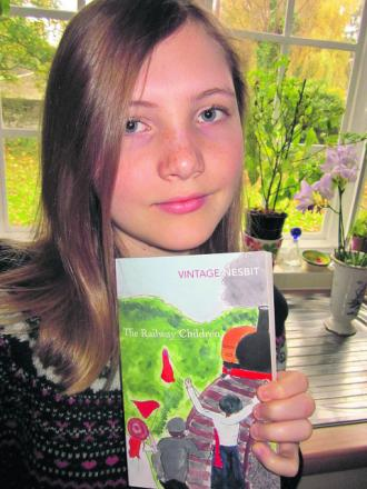 Rebecca Colling with her winning illustration on the cover of The Railway Children