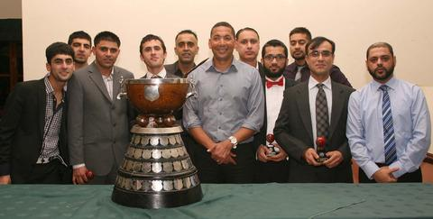 East Oxford line up with Phillip DeFreitas and the hefty Division 1 trophy