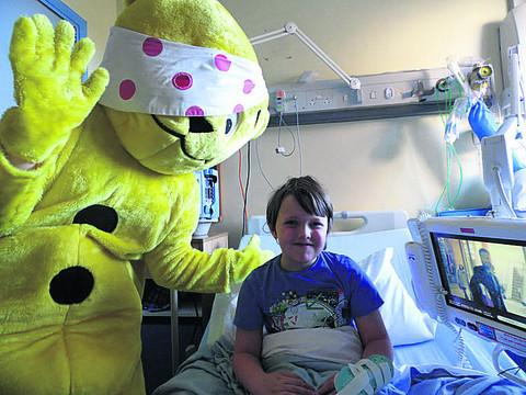 Bicester Advertiser: Pudsey meets seven-year-old Alistair Hartshorn at the Horton Hospital