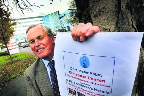 Nigel Talbot Rice at Oxford Children's Hospital with a poster for the Dorchester Abbey Christmas Concert. Picture: OX55587 Ed Nix