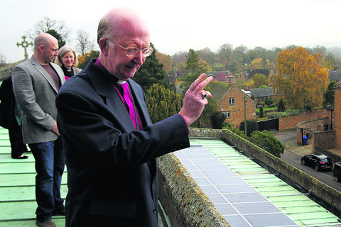 The Rt Rev John Pritchard, front, climbed to the top of St Peter and St Paul's Church in Deddington to give the panels his blessing on Thursday
