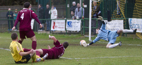 Grounded North Leigh debuant Ryan Brooks (No 10) sees Paulton keeper Kyle Phillips deny him a goal with a diving save,