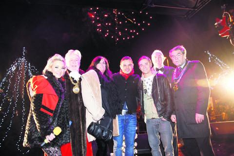 Coronation Street actors Ryan Thomas and Jack P Shepherd with officials in Banbury at the Christmas lights party