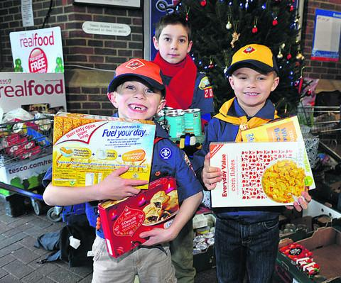 From left, Julian Israel, six, Preston Hamilton, 10, and Logham Hall, seven, helped with the food bank