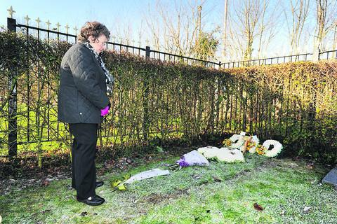 Bicester Advertiser: Jackie Flynn at the new grave plot for her late husband Peter. Picture: OX56052 Jon Lewis