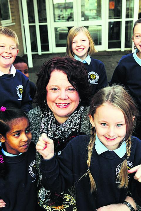 Lisa Biggin, left, and pupils at John Henry Newman School are celebrating being the city's most improved school