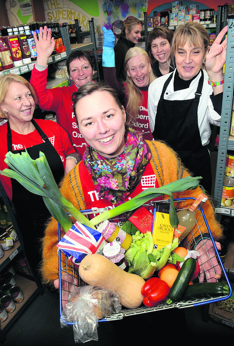 Manager Sarah Thorne and staff celebrate the People's Supermarket on Cowley Road reaching £100,000 in takings