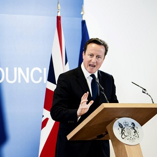 Prime Minister David Cameron speaks during a media conference after an EU summit in Brussels (AP)