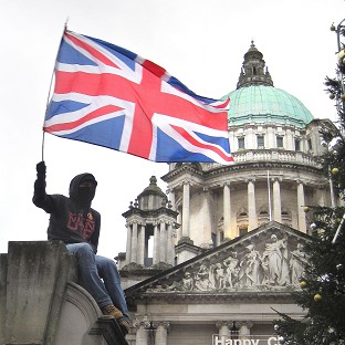 Loyalists taking part in a protest over the restrictions of flying the Union flag protesting outside Belfast City Hall