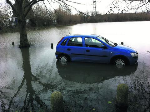 A car stuck in the water at the bottom of Hillview Road in West Oxford in last month's flooding