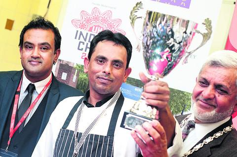 Winner Mohibur Rahman, centre, with competition founder Muhammed Ali, left, and deputy lord mayor Mohammed Abbasi