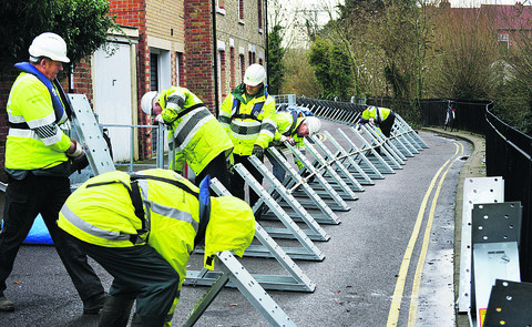 Flood barriers being installed at Osney Island in December 2012 during a previous flood warning period