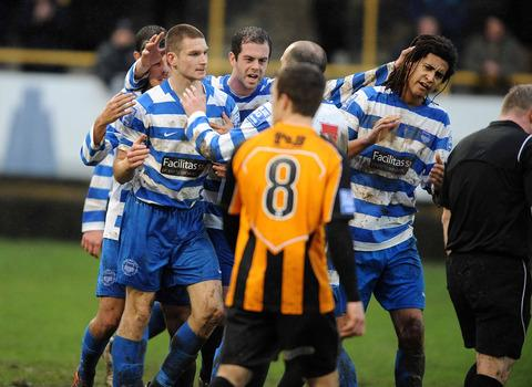 Oxford City defender Adam Learoyd (left) is mobbed by his teammates after heading the equaliser in their 3-1 defeat at Boston United's York Street on Saturday