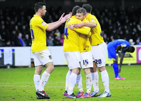 Alfie Potter (No 15) celebrates his header against AFC Wimbledon last Saturday  Picture: David Fleming