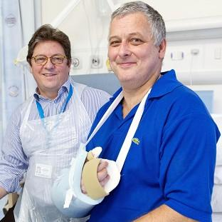Bicester Advertiser: Hand transplant patient Mark Cahill (right) with Professor Simon Kay at Leeds General Infirmary