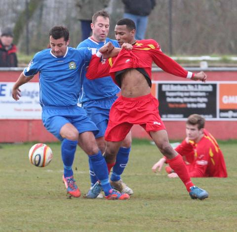 Banbury United striker Nabil Sharif has his shirt grabbed by a Barwell opponent