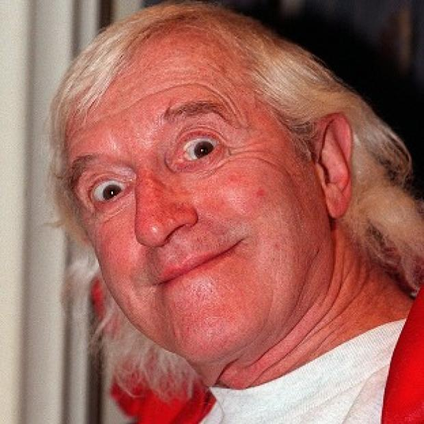 A watchdog says two unrelated adverts which refer to Jimmy Savile are harmful and offensive