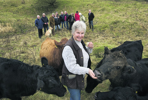 Some of the Brill villagers who own and look after a herd of cows that graze on the village common, with Patricia Stone, front. Picture: OX56549 Antony Moore