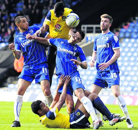 Lewis Montrose (left) in action for Gillingham against Oxford United last season