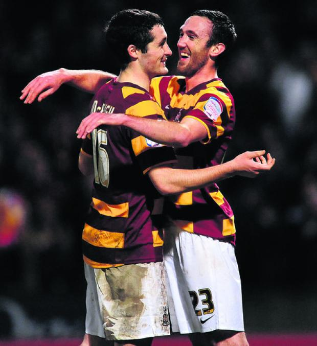 Carl McHugh (left) and Rory McArdle celebrate Bradford's win against Aston Villa on Tuesday