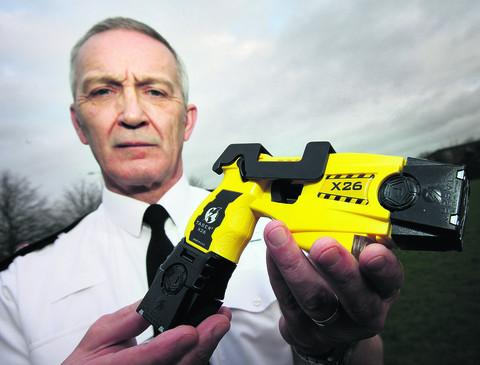 Supt Tony Ismay with a Taser at Bicester traffic base
