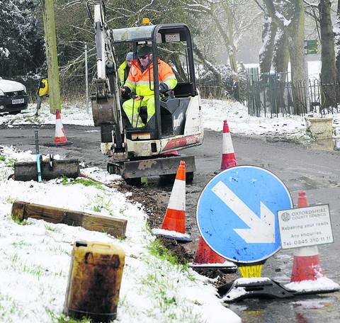 Workers remove the bollards in Ardley