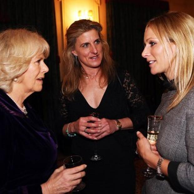 The Duchess of Cornwall talks to Olympic Equestrian riders Zara Phillips (right) and Tina Cook during a reception at Clarence House